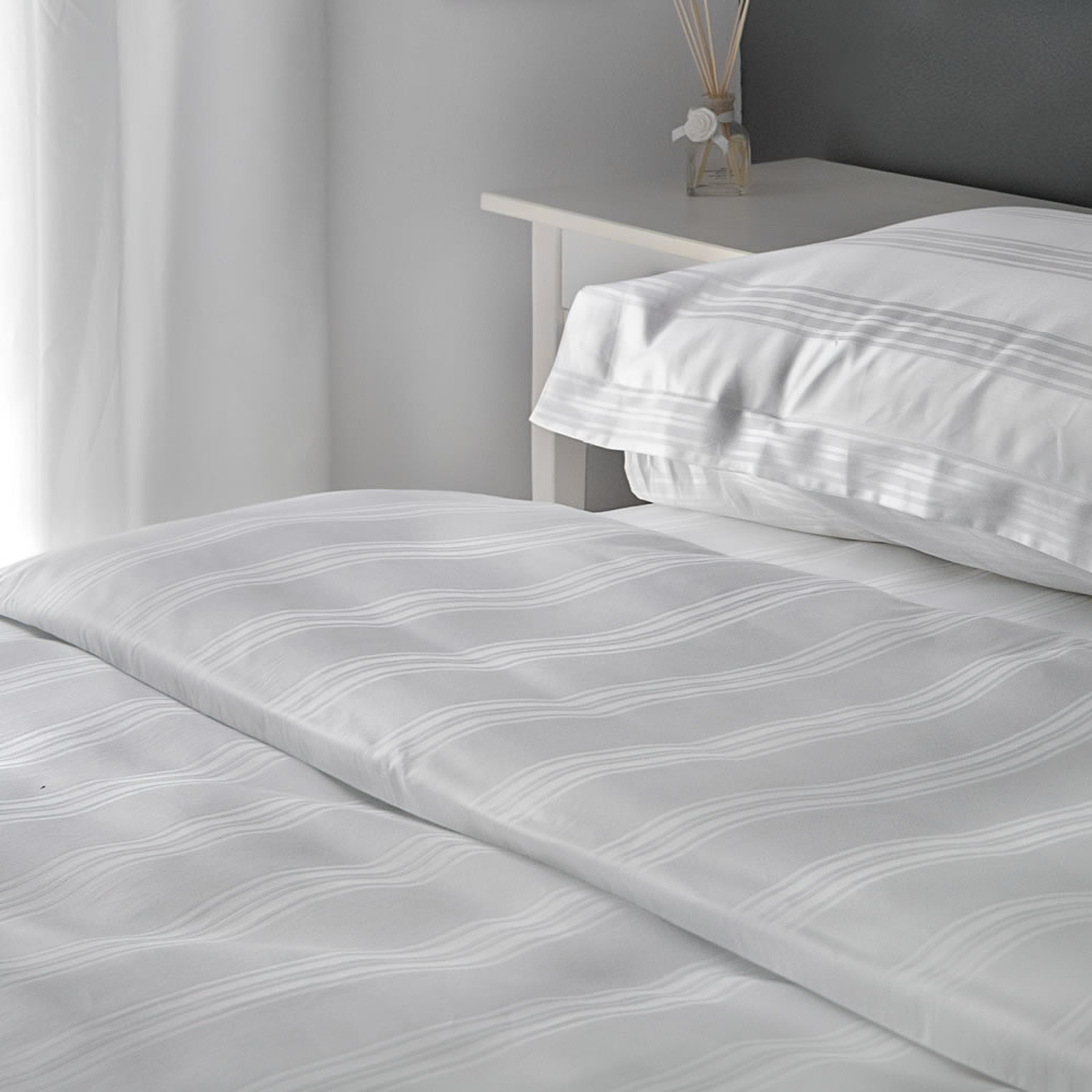 bed with Heathcote cotton flat sheet